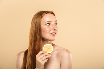 Beauty portrait of a smiling young topless redhead girl