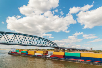 Container vessel passing a bridge on the Dutch river Waal in Nijmegen