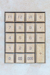 Weathered computer keypad with number buttons