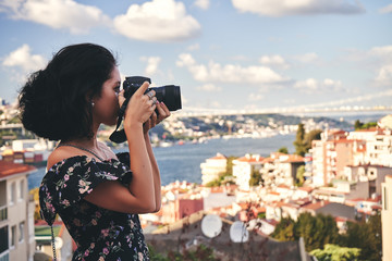 Wall Mural - Woman photographer, taking pictures of landscape in old district in Istanbul