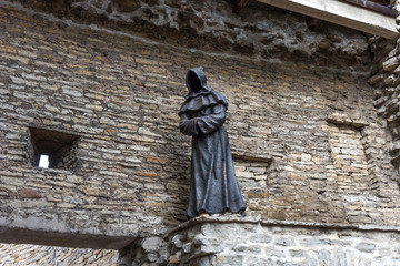 """One of the bronze """"Three Monks"""" at the Danish King's Garden in Old Town of Tallinn, Estonia"""