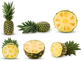 Collection pineapple fruit whole, cut in half with green leaves