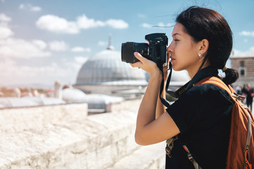 Wall Mural - Girl traveler photographer taking pictures of landscapes of istanbul