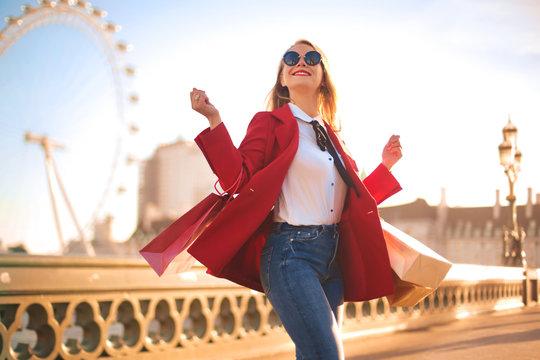 Beautiful woman doing shopping in London