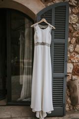 wedding dress hanging outside