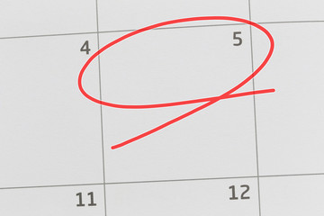 Focus on number 5 in calendar and empty red ellipse.