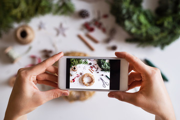 Christmas composition with smartphone on a white background.
