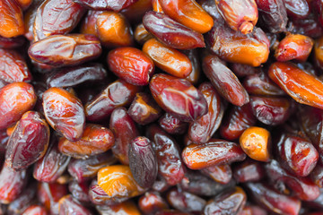 Background of dried dates of fruits close-up