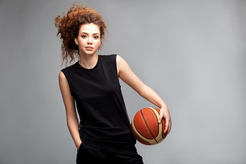 Very beautiful sportive girl model with afro curls and basket ball