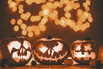 Three spooky pumpkin jack-o'-lanterns made for halloween