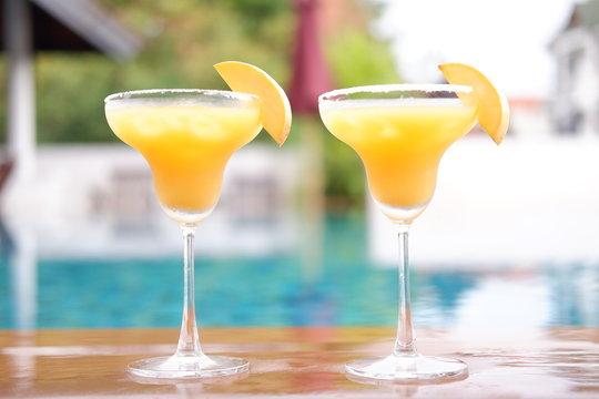 mango margarita cocktail at swimming pool