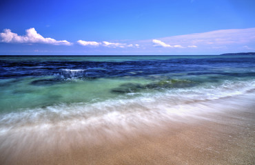 Beautiful summer landscape with sea waves on the beach