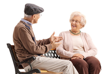 Elderly man and woman having a conversation