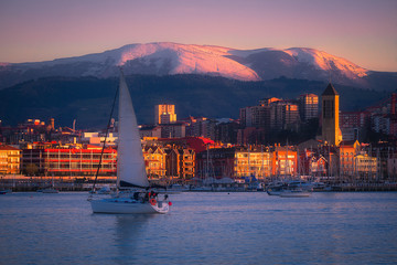 Getxo village with a sailboat in winter