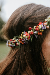 Close up of brunette bride with flower wreath