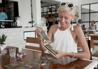 Woman is reading Tarot cards