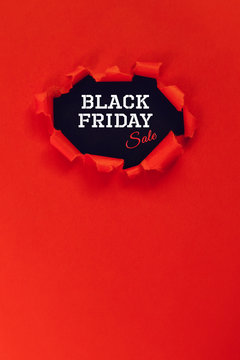 hole in red paper. text black friday sale. copy space