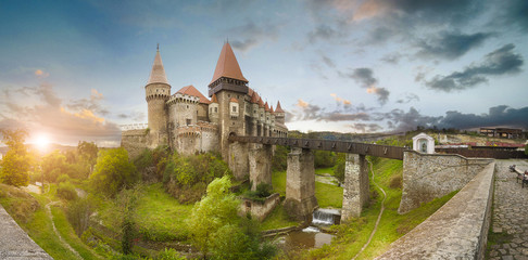 Aluminium Prints Castle Beautiful spring panorama view of the Corvin Castle, also known as Hunyad Castle or Hunedoara Castle is a Gothic-Renaissance castle in Hunedoara, in the region of Transylvania, Romania at sunset
