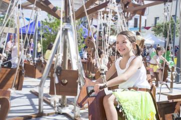 Child girl having fun at Human powered carousel