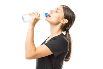 Sporty Young Woman Drinking Water From Bottle After Workout
