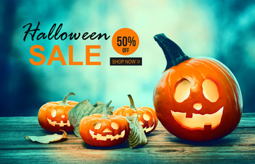 Halloween sale with pumpkins on a spooky forest at night