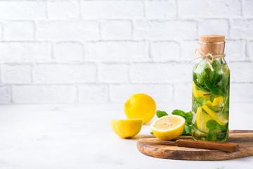 Fresh cool lemon lime mint infused water detox drink