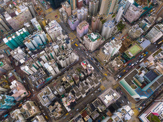Aerial view of Hong Kong apartments in cityscape background, Sham Shui Po District. Residential district in smart city in Asia. Top view of buildings.