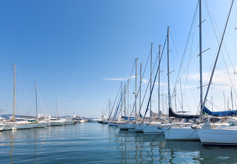 A sunny day in the harbour with yachts and sailing boats