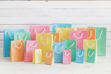 paper bags on wooden background