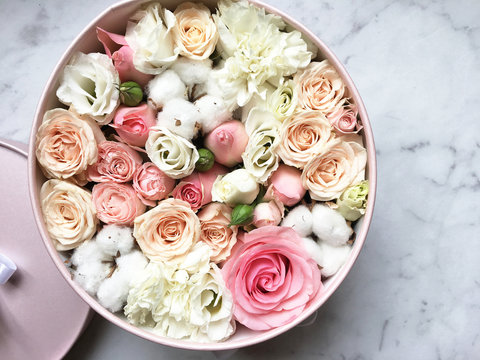 Flowers in a box roses and colorful macaroons macaroni marshmallow cotton