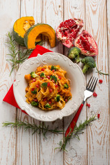 pasta with broccoli pumpkin and pomegranate