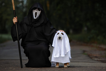 dog and owner dressed for Halloween as death and ghost