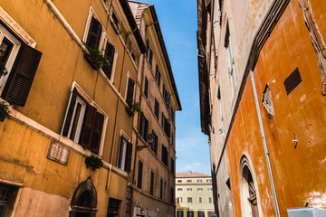 Old buildings in a narrow alley in Rome