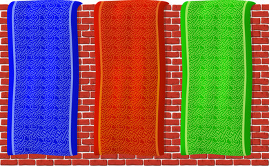 Various color banners on red brick wall