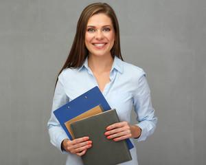 Woman teacher holding book.