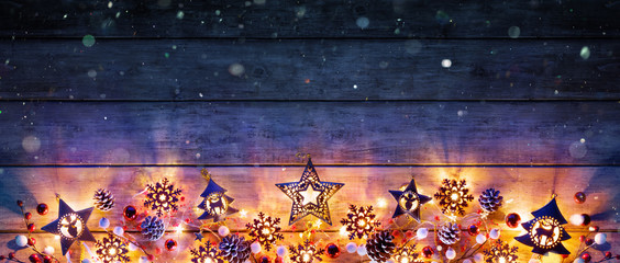 Christmas Lights And Decoration On Rustic Wooden Plank