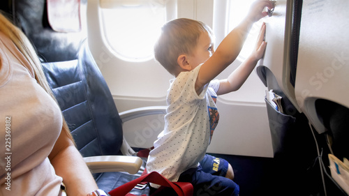 Little 2 Years Old Boy Playing With Foldable Table In Airplane