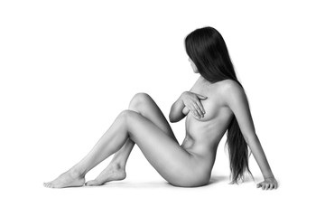 Art nude, perfect naked body, sexy woman isolated on white background, black and white studio shot
