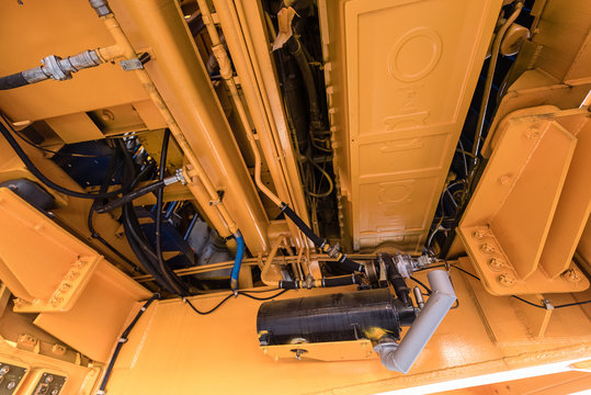 Engine compartment in a giant yellow dump truck