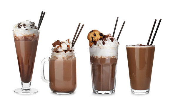 Set with delicious chocolate milk shakes on white background