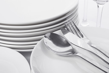 Set of clean tableware on white background, closeup. Washing dishes