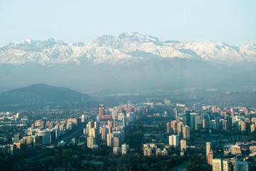 Urban sprawl in the city of Santiago in Chile with the Andes Mountains in the background
