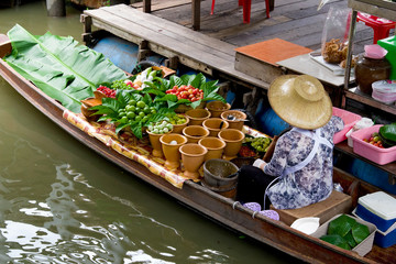 Traditional merchant in Taling Chan floating market, Thailand