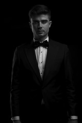 black and white portrait of young man in tuxedo