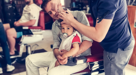 one year toddler and father, babys first haircut