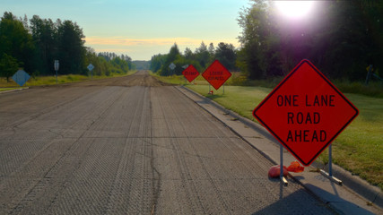 Orange Warning Road Signs on highway at construction site
