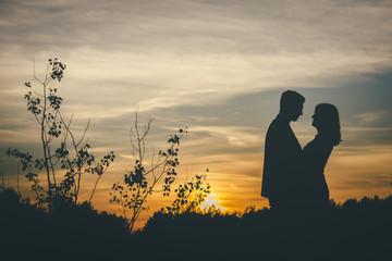 loving wedding couple hugging sihouette
