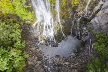 Aerial drone view of a beautiful waterfall and lake