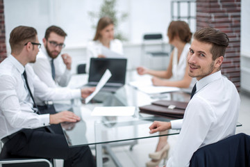 businessman and business team sitting at the Desk