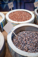 Close up of raw mixed purple, black rice in a bowl. Rich in nutrients and is a good source of vitamins, minerals, antioxidant, high in fiber. Healthy eating and eat well concept. Mock up label ready.